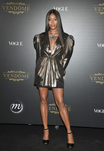 Naomi Campbell completed her look with black ankle-strap peep-toes.