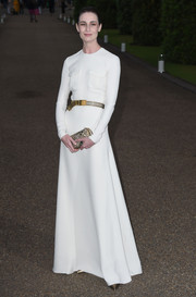 Erin O'Connor was as elegant as ever at the Wimbledon party in a long-sleeve white Ralph Lauren gown with double pockets and an open back.