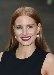 Jessica Chastain glammed up her simple 'do with a pair of dangling diamond earrings.