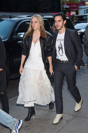 Chloe Sevigny was tough-chic in a black leather bomber jacket while headed to the Vogue.com Met Gala cocktail party.