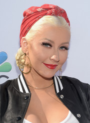 Christina Aguilera adorned her coiffure with a red head scarf for the 'Voice' karaoke for charity event.