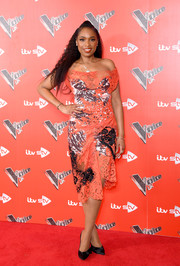 Jennifer Hudson was edgy yet sophisticated in an orange, black, and white off-the-shoulder lace dress by Vivienne Westwood at the  'Voice' UK photocall.