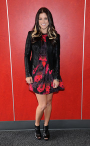Cassadee Pope was tough-chic in a black leather jacket layered over a printed mini dress during the debut of album.