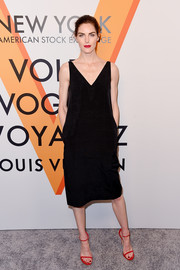 Hilary Rhoda's red slim-strap sandals worked beautifully with her black dress!