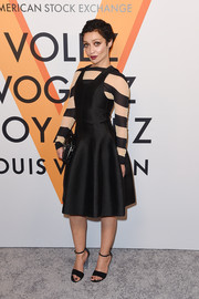 Ruth Negga layered a sleeveless LBD over a boldly striped top, both by Louis Vuitton, for the 'Volez, Voguez, Voyagez' exhibition opening.