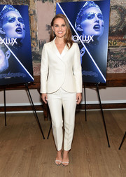 Natalie Portman styled her suit with barely-there sandals.
