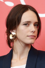 Stacy Martin attended the Venice Film Festival photocall for 'Vox Lux' wearing her hair in a casual updo.