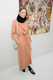 Jaime King cozied up in a long peach coat for the Voyeur by Vanessa Prager event.