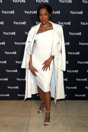 Regina King's white coat and asymmetrical dress at the Vulture awards season party were a very stylish pairing.