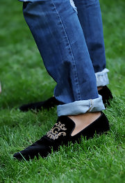 Stefano paired his cuffed jeans with cool velvet slippers from his own collection.