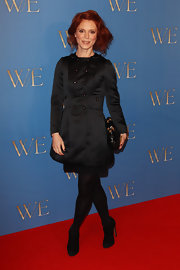 Emilia Fox wore a satin military-style coat dress to the UK 'W.E.' premiere.