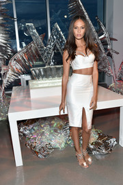 Joan Smalls showcased her cleavage and abs in a strappy white corset top by Misha Collection while celebrating the opening of W Dubai.