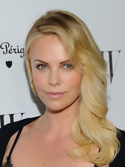 Charlize Theron wore her ultra-blond hair in feathered waves at the 'W' Magazine 69th Annual Golden Globe Awards Celebration.