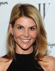 Lori Loughlin attended the 'W' Magazine Golden Globe Awards Celebration wearing her layered cut tousled and slightly wavy.