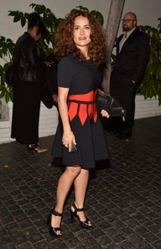 Salma Hayek showed up to W Magazine's Golden Globes bash wearing a fun dress with a bright orange print.