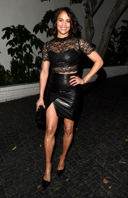 Paula Patton went for a head-to-toe black look in a sheer lace top with a leather bandeau underneath and finished her outfit with a fitted leather skirt.