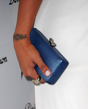 La La Anthony complemented her white dress with an elegant blue hard-case clutch when she attended the W Magazine Golden Globes party.