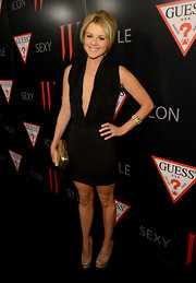Ali wasn't afraid to bare it all in this deep-plunging cowl-neck LBD at the W party.