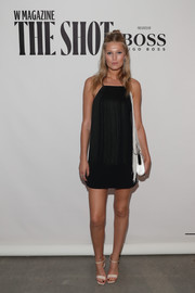 Nude satin sandals finished off Toni Garrn's outfit.
