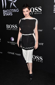 Rose McGowan kept it casual yet stylish in a black-and-white boatneck blouse during the W Magazine Shooting Stars exhibit opening.