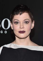 Rose McGowan injected a goth touch via a dark berry lip.