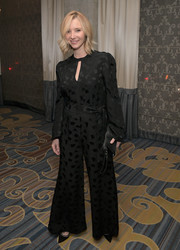 Lisa Kudrow complemented her jumpsuit with a simple leather wristlet.