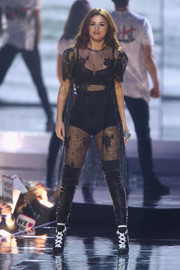 Selena Gomez performed on stage during WE Day California wearing a sheer black dress by Houghton.