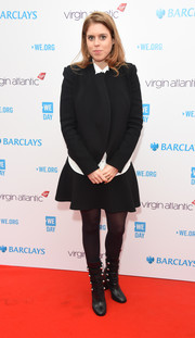 Princess Beatrice toughened up her skirt suit with a pair of military-chic boots.