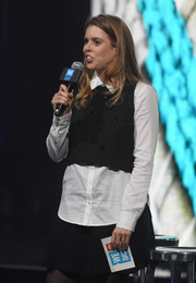 Princess Beatrice talked on stage at the WE Day celebration wearing a black vest over a white button-down.