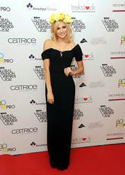 Pixie Lott looked divine in her black corseted off-the-shoulder gown at the WGSN Global Fashion Awards.