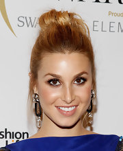 Whitney Port enhanced her brown eyes with some smoky shadow and lengthy false lashes at the WGSN Global Fashion Awards. Nothing ups the glamour quotient like a well-placed pair.