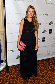 Charlotte Ronson looked demure at the WGSN Global Fashion Awards wearing a floor-length black gown with sheer lace inset.