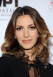 Dawn Olivieri attended a charity poker tournament wearing her hair in tousled wavy layers.