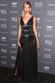 Karlie Kloss was sweet and sexy in equal parts wearing this sheer, bow-adorned gown by Miu Miu at the WSJ. Magazine 2016 Innovator Awards.