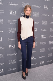 Martha Hunt completed her outfit with a pair of navy slacks, also by Céline.