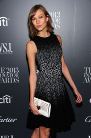Karlie Kloss complemented her cute dress with a studded white clutch when she attended the Innovator of the Year Awards.