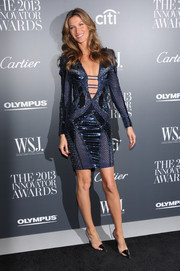 Gisele Bundchen was easily the center of attention in this multitextured blue Atelier Versace dress with a down-to-there neckline during the Innovator of the Year Awards.