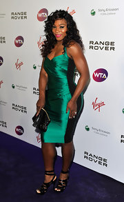 Serena Williams is a longtime fan of Burberry. At a pre-Wimbledon fete in London, Serena showed off her athletic curves in a striking custom-made emerald halter cocktail dress.