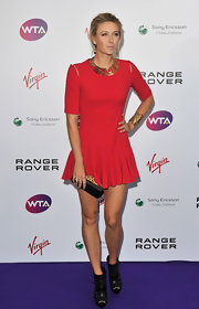 Maria was lovely in a red cutout cocktail dress for the Pre-Wimbledon Party.