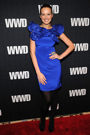 Petra Nemcova donned black peep toe pumps adorned with bows. The heels blended in with her opaque tights, leaving the focus on an eye catching cobalt blue evening dress.