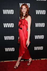 Karen set the red carpet afire in Marc Jacobs' scarlet silk dress and matching feathered heels.