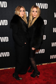 Ashley Olsen wore Louis Vuitton Coquette Open Toe Pumps over  zig zag tights. The rest of her ensemble was kept black and moody.