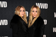 Actors Ashley Olsen and Mary-Kate Olsen attend the Women's Wear Daily 100 Anniversary Gala at Cipriani 42nd Street on November 2, 2010 in New York City.