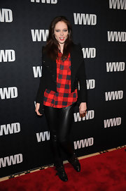 Coco Rocha donned strappy motorcycle boots. The model paired the flat boots with liquid leggings and a plaid button-down shirt.