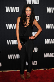 Jessica wears a styling black jumpsuit with leopard print booties.  This Erin Fetherston for Juicy Couture design is perfect edgy attire for the 'WWD' 100th Anniversary Gala.