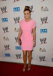 Carmen Electra looked like a Barbie in this true pink peplum dress.