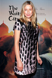 Sybilla Budd paired her lack leggings with a printed dress while attending the premiere of 'The Waiting City'.