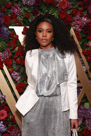 Gabrielle Union layered a cropped white jacket over a silver jumpsuit for the Live Unforgettable Dinner Series.