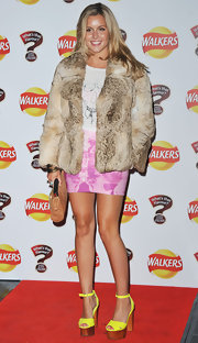 Caggie Dunlop attended the Walkers launch party wearing a fab fur jacket.