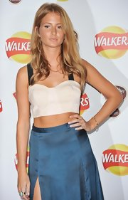 Millie Mackintosh showed off her sexy tummy by wearing a white crop-top paired with a thigh-split maxi skirt during the Walker 'What's That Flavor?' Launch.
